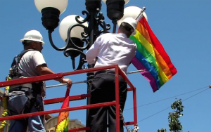 Faulconer in Gaslamp installing one of 124 rainbow flags