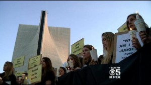 Students and parents staged a protest over proposed morality clauses for Archdiocese of San Francisco teachers at Saint Mary's Cathedral on February 18, 2015. (CBS)