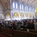 Packed church for Fathers Illo and Driscoll
