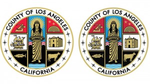 Religious groups say Los Angeles County is continuing to display a county seal that includes the Christian cross, at right, which violates a legal agreement. (L.A. County / Associated Press)