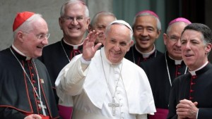 L.A. Archbishop Jose H. Gomez, second from right, helps usher Pope Francis out as he leaves the Pontifical North American College on Saturday after a conference sponsored by the Los Angeles archdiocese on the canonization of Father Junipero Serra. (Franco Origlia / Getty Images)