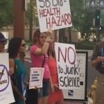 Protesters greet abortion reversal pill doctor