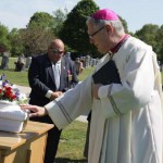 Bishop buries unborn baby discarded in sewer