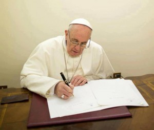Pope-Francis-writing--300x254
