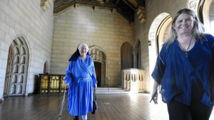 Sister Rita Callanan, 77, left, and restaurateur Dana Hollister walk inside the main room of a villa at the former convent in Los Feliz. (Mel Melcon / Los Angeles Times)