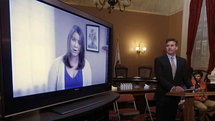 Dan Diaz, the husband of Brittany Maynard, watches a video of his wife, recorded 19 days before her assisted suicide death. In the video, Maynard asked California lawmakers to adopt an aid-in-dying law. (Rich Pedroncelli / AP)