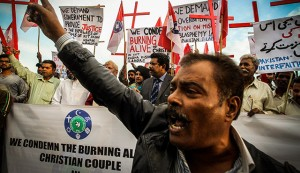 Pakistanis protest Christians couple burned alive for alleged blasphemy in Islamabad, Pakistan on November 14, 2014. The U.S. bishops are calling on people of all faiths to pray for those facing religious perseciuion in the middle east and elsewhere. (photo: CNS photo/Sohail Shahzad, EPA)