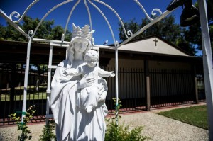 The Our Lady of Miracles statue located at the front of the Our Lady of Miracles Catholic School in Gustine. The Roman Catholic Diocese of Fresno has confirmed that the school will not reopen for the upcoming school year and will close its doors Aug. 1. (credit: Andrew Kuhn/Merced Sun-Star)