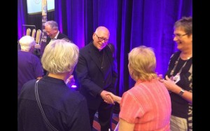 Fr. Jack McClure greets women after WOW panel. (NCR photo/Tom Fox)