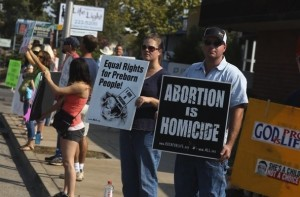 Protest in Redding CA on Aug. 22 (photo from Record Searchlight)