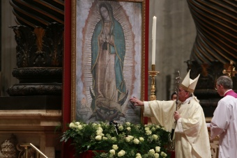 Pope Frances touches image of Our Lady of Guadalupe at St. Peter's Basilica (photo from CNA article)
