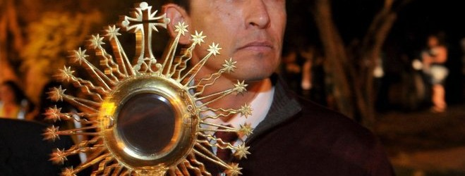 While waiting for the candlelight procession to the Ventura mission, the last one Serra founded, Deacon David Muñoz, from Our Lady of the Sorrows in Santa Barbara, said even though there has been tension surrounding the nine missions Serra founded, the good he did overpowers that. Muñoz held a gold chalice Serra used while at the Santa Barbara parish as he waited for the Santa Barbara mission to be built. (photo credit: Joseph A. Garcia)