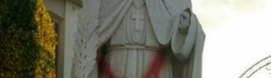What appears to be a satanic star was painted on a religious statue at St. Emydius Catholic Church. (Screenshot from NBC video)