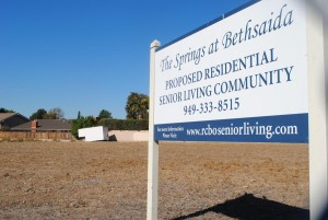 A sign announces the development that the Diocese of Orange has planned for the swath of empty land in this 2012 photo. (photo: Theresa Cisneros/OC register)