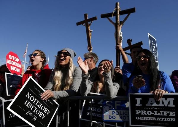 "From left, abortion opponents Bianca Magana, Mikaela Magana, Courtney Elium and Bianca E. Magana, gather in San Francisco's Civic Center for the ""Walk for Life"" rally and march, Saturday, Jan. 25, 2014, in San Francisco. (Image source: AP/Beck Diefenbach)"