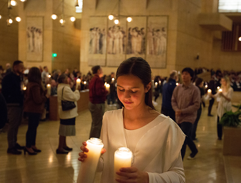 "Members of the assembly participate in ""One Life, One Light"" candle ceremony during the Requiem for the Unborn. (photo/Victor Aleman)"