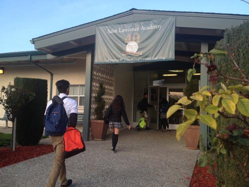 Students arrive at St. Lawrence Academy high school in Santa Clara on Thursday morning. The Diocese of San Jose will shut down the school at the end of the school year. (Sharon Noguchi)