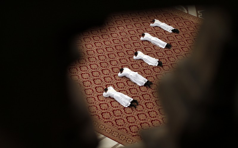 Priests lie on the floor as Pope Francis leads a Mass during their ordination ceremony in St Peter's Basilica (AP Photo/Alessandro Bianchi, Pool)