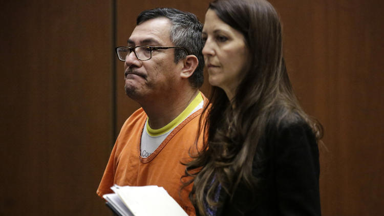 Erwin Mena appeared in a downtown Los Angeles courtroom on Wednesday with his attorney, Denise Daniels. He was sentenced to one year in county jail and one year of supervised release after pleading guilty to one count of grand theft. (Irfan Khan / Los Angeles Times)