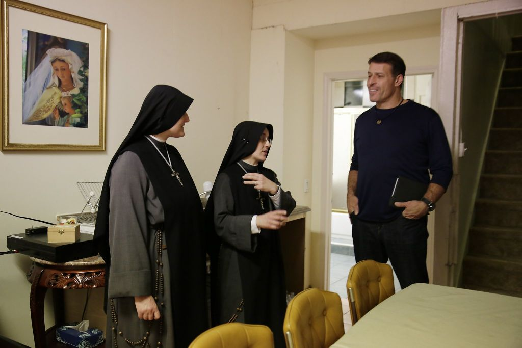 Tony Robbins (right), motivational speaker and author, talks with Sister Mary Valerie (center) and Sister Mary Benedicte (left) during a tour of Fraternite Notre Dame Mary of Nazareth Soup Kitchen while meeting to discuss solutions to their eviction on Thursday, February 11, 2016 in San Francisco, California (Photo: Lea Suzuki, The Chronicle)