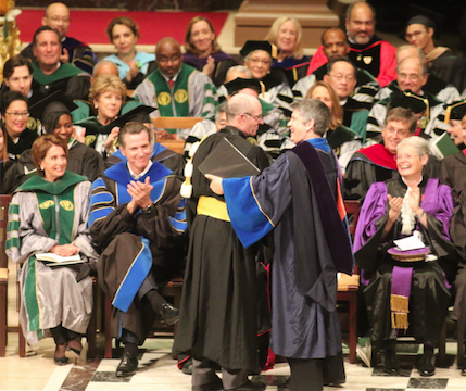 Father Fizgerald being installed as USF President. To the left are Nancy Pelosi and Gavin Newsom.