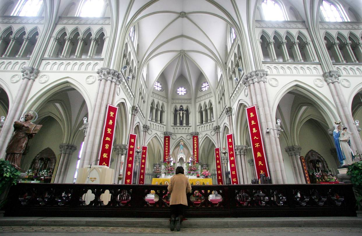 A Chinese Catholic prays on Easter Sunday at the state-sanctioned Saint Ignatius Cathedral in Shanghai in 2005. PHOTO: REUTERS