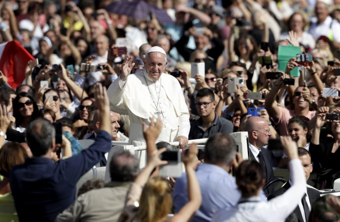 Pope Francis waves to faithful at the end of a jubilee mass in St. Peter's Square, at the Vatican, Sunday, Oct. 9, 2016. The pontiff has named 17 new cardinals _ 13 of them under age 80 and thus eligible to vote in a conclave to elect his successor. (Credit: AP Photo/Andrew Medichini.)