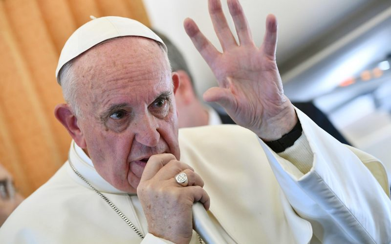Pope Francis answers a question from reporters on the way back to Rome from Sweden (Ettore Ferrari/Pool Photo via AP)